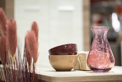 Decorative items in the interior, a Beautiful vase on the table. Cozy items for the home.