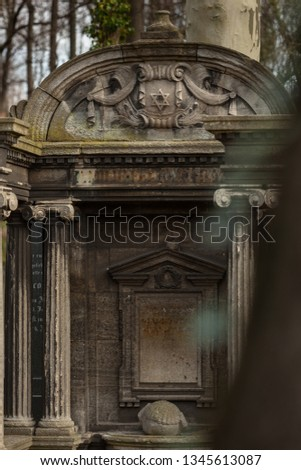 Decorative Jewish Tomb with Columns and David's Star at the Jewish Cemetry in Berlin-Prenzlauer Berg District #1345613087