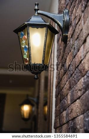 decorative lantern, lantern on the wall, lantern in a cafe