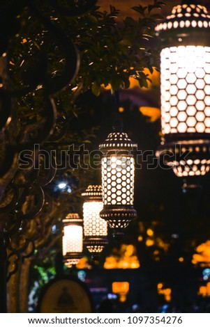 Decorative lanterns in Ramazan month on Sultanahmet square, Istanbul, Turkey at night. #1097354276