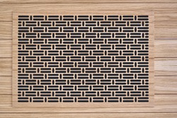 Decorative lattice. Wooden vent cover in wooden slats ceiling. Bottom view