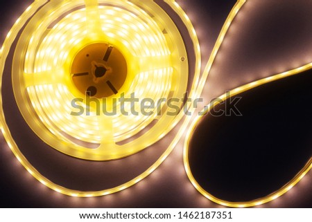 decorative LED strip home lighting on a purple-pink background top view close-up