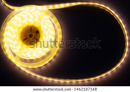 decorative LED strip home lighting on a purple-pink background top view mockup  close-up