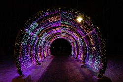 Decorative lighting tunnel at night in winter