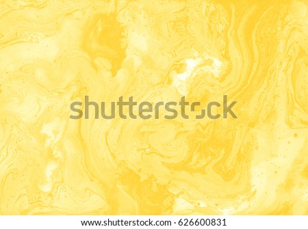 Decorative marble texture. Yellow colour. Abstract painting, can be used as a trendy background for wallpapers, posters, cards, invitations, websites and other projects. Liquid ink.