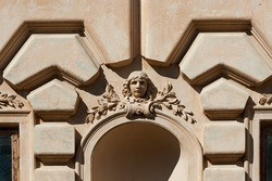 Decorative mascaron on the facade of the Badeni palace in Koropets, Ukraine