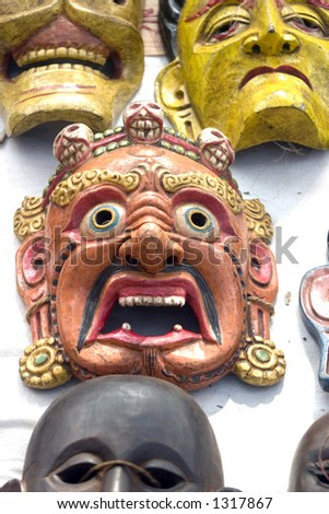 Decorative masks or wall hangings for sale at the world famous Anjuna flea market in Goa, India
