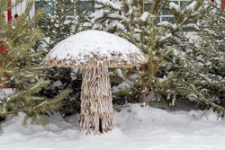 Decorative mushroom made of branches of trees. Wicker Sculpture. Christmas decoration on the street. Street Christmas decoration.