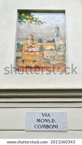 Decorative Painted Plaque on Wall with Italian Street Sign Translated as 'Mister D. Comboni Street'  Photo stock ©