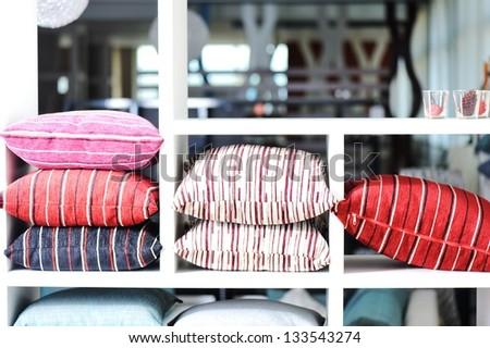 Decorative pillow on shelves
