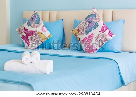 Decorative pillow with white towel in bed,Room service,Thailand.