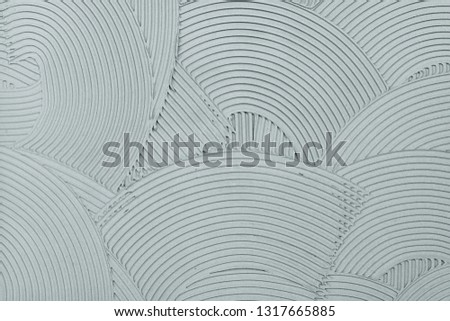 Decorative plaster wall finish texture, modern urban wavy overlapping concentric circle pattern background #1317665885