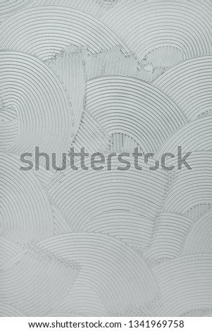 Decorative plaster wall finish texture, modern urban wavy overlapping concentric circle pattern background #1341969758