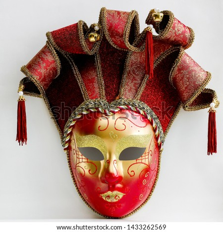 Decorative red and gold Venetian carnival mask #1433262569