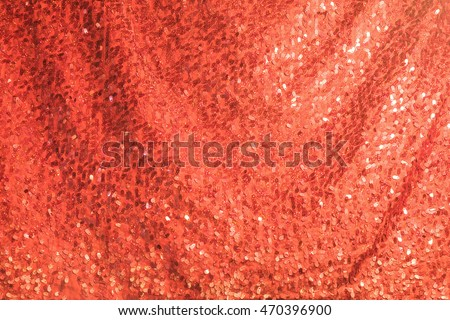 Decorative red glittering sequins on red cloth textile texture fashion background. Elegant red shiny and sparkle elements on red fabric, Christmas, Valentines, wedding background #470396900