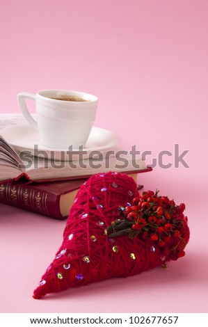 Decorative red heart with books and coffee - stock photo