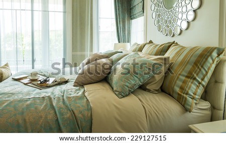 Decorative set with book,tea set and glasses on the bed