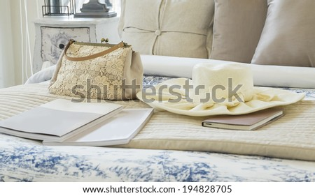 Decorative set with vintage bag,hat,books on the bed