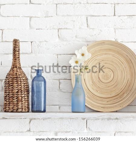 decorative shelf on white brick ...