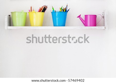 Decorative shelf on white wall as detail of kid interior