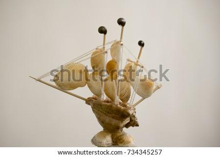 decorative ship of seashells on a light background #734345257