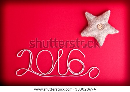 decorative star on hot red background christmas and 2016 new year theme place for