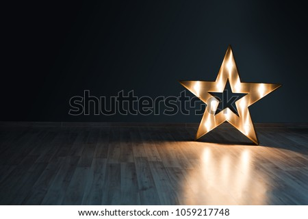 Decorative star with lamps on a background of wall. Modern grungy interior  #1059217748