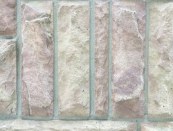 Decorative stone tiles on a wall texture.