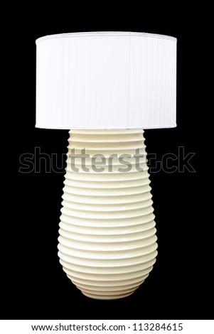 Decorative table lamp isolated on black background