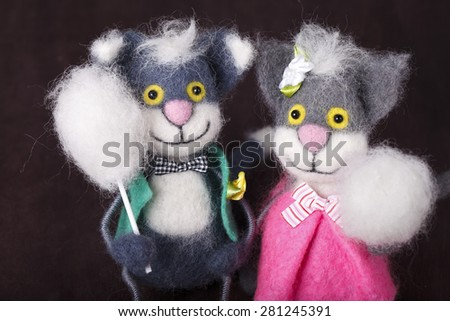 decorative toy cat with buttons instead of eyes