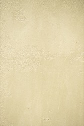 Decorative traditional venetian plaster on the wall. Stone texture grain drawing. Beige color seamless stone texture. Exterior building structure backdrop. Silica sand cement wall plaster.
