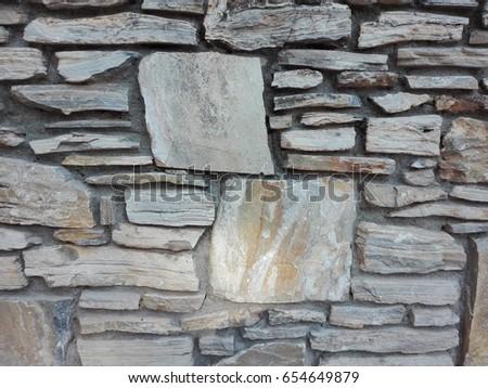 Decorative wall of stone tiles. | EZ Canvas