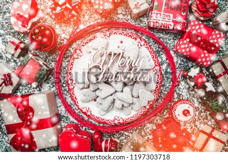 Decorative wands, with decorative Xmas plate and biscuits, cookies inside, on gray, stone, marble background, above view, greeting card #1197303718
