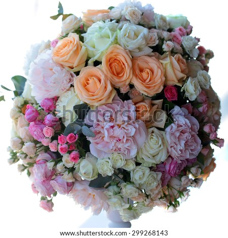 Decorative wedding nosegay of fresh beautiful flowers of roses and peony pink violet purple yellow lilac and orange colours in slim vase isolated on white background, square picture