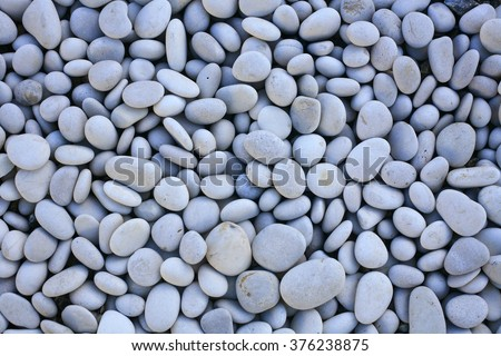 decorative white stones , round stones on white background , Stones or Gravel for building, floor or wall. Seamless Texture. pebbles isolated on a white background