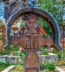 Decorative wooden carved cross with Romanian traditional motifs, specific for Maramures area, village Ieud Deal, Romania.