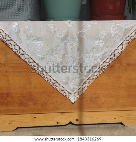 Decorative wooden chest and white quilt Stok fotoğraf ©