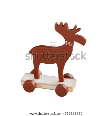 Decorative wooden Christmas elk toy isolated on white. Handmade christmas ornament.