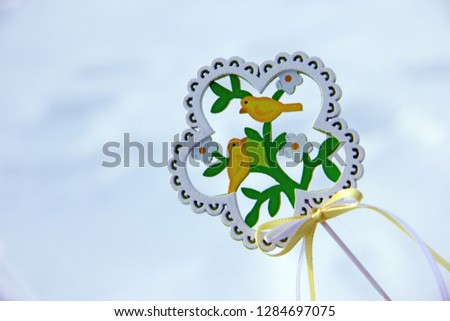 Decorative wooden element in the form of a flower with birds and flowers on the theme of spring. Background on the theme of spring, waiting for spring, waiting for spring #1284697075