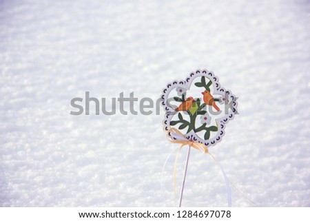 Decorative wooden element in the form of a flower with birds and flowers on the theme of spring. Background on the theme of spring, waiting for spring, waiting for spring #1284697078