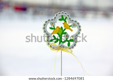 Decorative wooden element in the form of a flower with birds and flowers on the theme of spring. Background on the theme of spring, waiting for spring, waiting for spring #1284697081