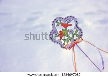 Decorative wooden element in the form of a flower with birds and flowers on the theme of spring. Background on the theme of spring, waiting for spring, waiting for spring #1284697087
