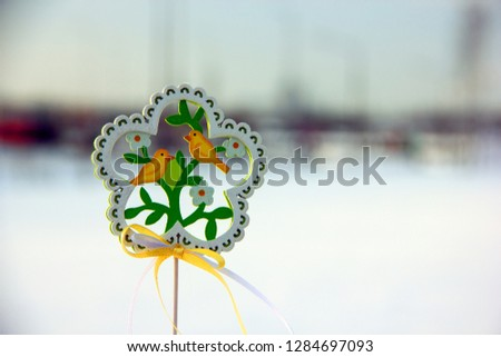 Decorative wooden element in the form of a flower with birds and flowers on the theme of spring. Background on the theme of spring, waiting for spring, waiting for spring #1284697093