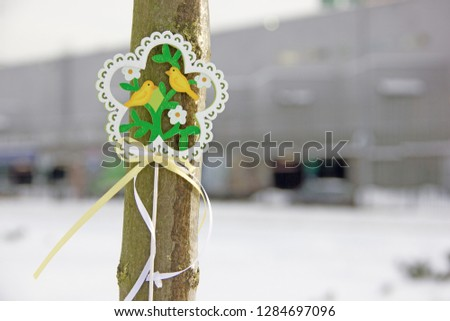 Decorative wooden element in the form of a flower with birds and flowers on the theme of spring. Background on the theme of spring, waiting for spring, waiting for spring #1284697096
