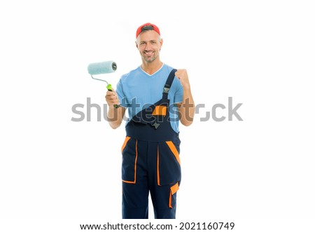 Decorator creative work. Paint and renovate. Decorator painting wall. Man in cap hold paint roller white background. Worker painter decorator concept. Professional occupation. Education for decorator Stok fotoğraf ©