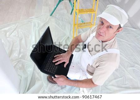 Decorator using laptop
