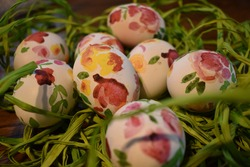Decoupage Easter eggs on straw decoration