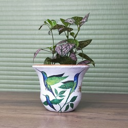 Decoupage on plastic pottery. Decoupage is the art of decorating an object by gluing paper napkins or cutouts.
