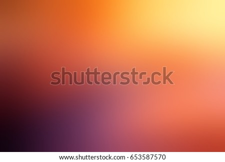 Deep autumn abstract background. Hot watercolor texture. Yellow, orange, violet blurred background. Fire empty backdrop. Abstract dawn in sky. Hot golden glow.