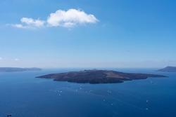 deep blue aegean sea on cyclades santorini volcano island with seagull and small cloud